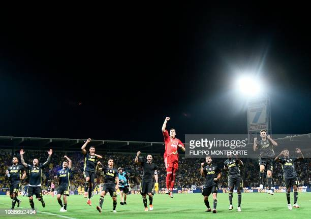 Juventus players celebrate after the Italian Serie A football match between Frosinone and Juventus Turin on September 23 2018 at the BenitoStirpe...