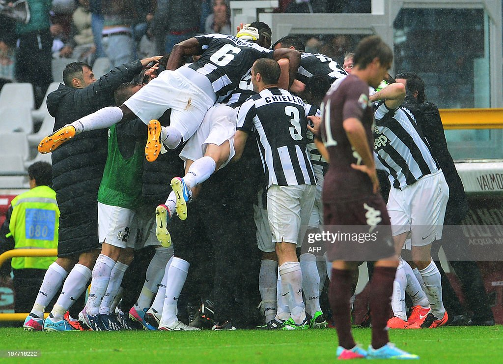 Juventus' players celebrate after their Chilean midfielder Arturo Vidal scored a goal during the Italian Serie A football match between Torino and Juventus on April 28, 2013 at the Olympic Stadium in Turin.