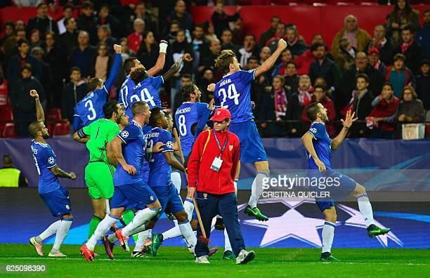Juventus' players celebrate after winning during the UEFA Champions League football match Sevilla FC vs Juventus at the Ramon Sanchez Pizjuan stadium...