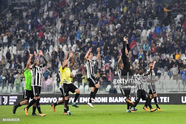 Juventus' players celebrate after winning the Italian Serie A football match Juventus vs Chievo at the Allianz stadium in Turin on September 9 2017 /...