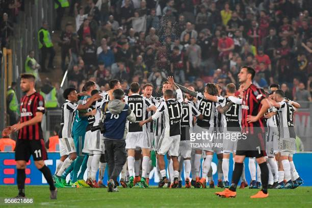 TOPSHOT Juventus' players celebrate after winning the Italian Tim Cup final Juventus vs AC Milan at the Olympic stadium on May 9 2018 in Rome