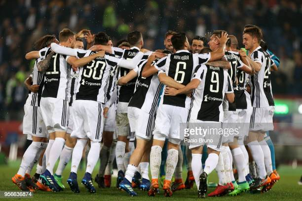 Juventus players celebrate after winning the TIM Cup Final between Juventus and AC Milan at Stadio Olimpico on May 9 2018 in Rome Italy