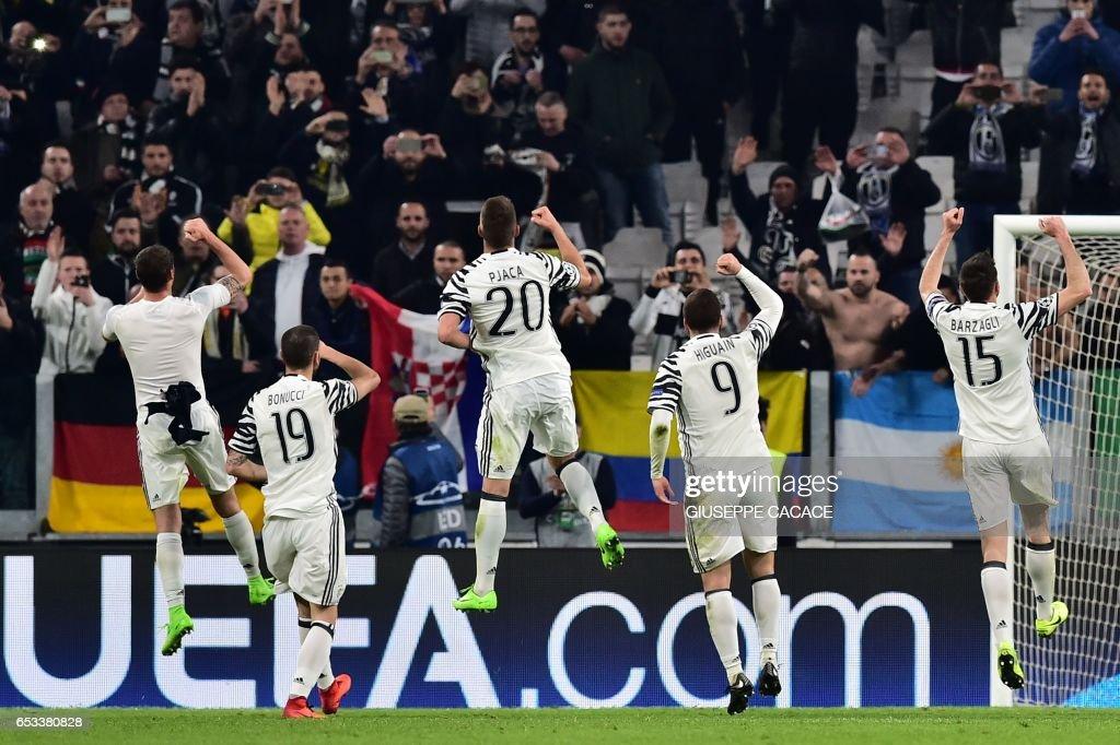 Juventus players celebrate after winning the UEFA Champions League football match Juventus vs FC Porto on March 14, 2017 at the Juventus stadium in Turin. Juventus won 1-0. /