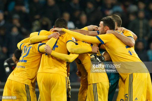 Juventus' players celebrate at the end of the Italian Serie A football match Napoli vs Juventus on December 1 2017 at the San Paolo stadium in Naples...