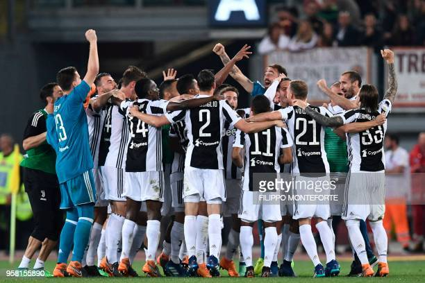 Juventus players celebrate at the end of the Italian Serie A football match AS Roma vs Juventus at the Olympic stadium on May 13 2018 in Rome...