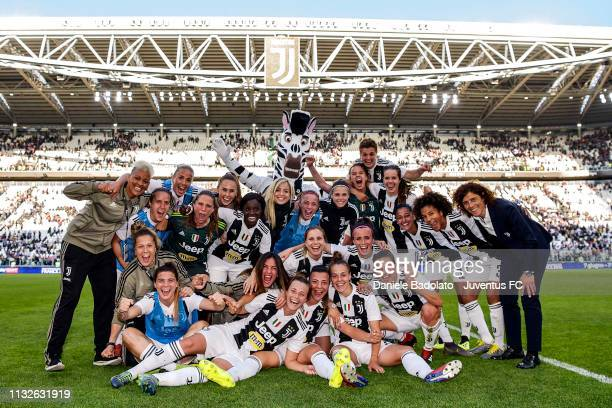 Juventus players celebrate at the end of the Women Serie A match between Juventus and ACF Fiorentina at Allianz Stadium on March 24, 2019 in Turin,...
