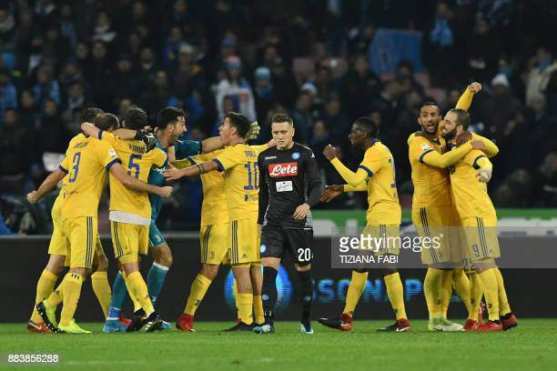 Juventus' players celebrate next to Napoli's midfielder from Poland Piotr Zielinski at the end of the Italian Serie A football match Napoli vs...