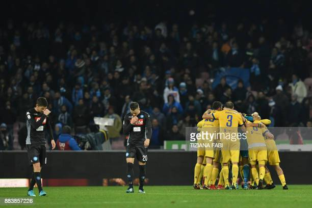 Juventus' players celebrate next to Napoli's midfielder from Poland Piotr Zielinski and Napoli's midfielder from Brazil Jorginho at the end of the...