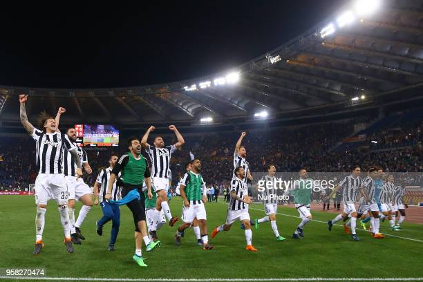 Juventus players celebrate the victory of the Serie A championship at Olimpico Stadium in Rome Italy on May 13 2018 during Serie A match between AS...