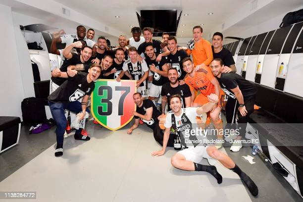 Juventus players celebrate the winning of the Italian championship 20182019 after the Serie A match between Juventus and ACF Fiorentina on April 20...
