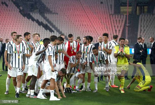 Juventus players celebrate their league champions title at the end of the Italian Serie A football match Juventus vs Roma on August 1, 2020 at the...