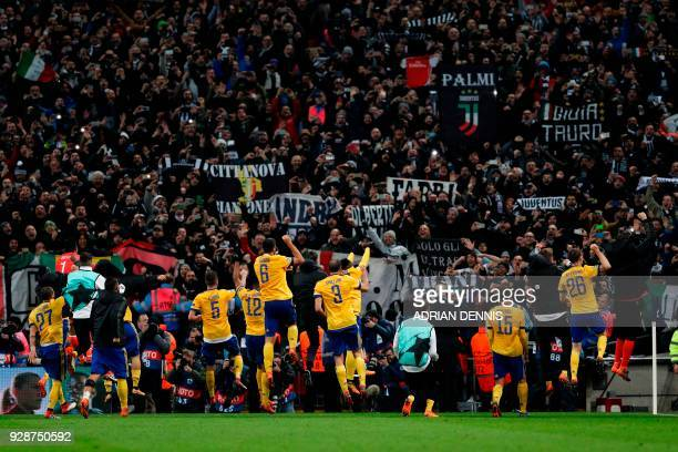 Juventus players celebrate their victory at the final whistle during the UEFA Champions League round of sixteen second leg football match between...