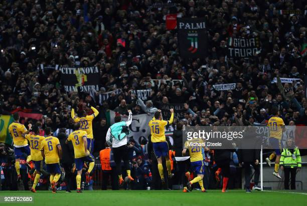 Juventus players celebrate victory with their fans during the UEFA Champions League Round of 16 Second Leg match between Tottenham Hotspur and...
