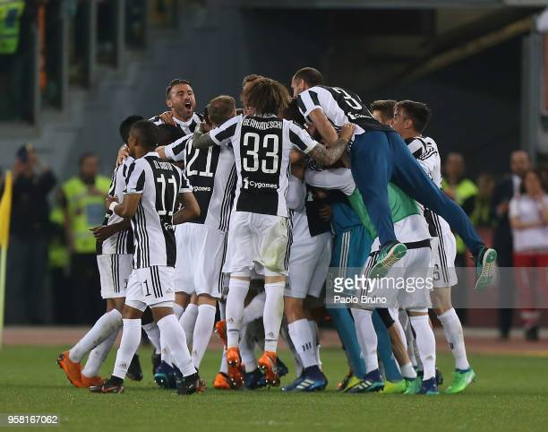 Juventus players celebrate winning the Champioship after the Serie A match between AS Roma and Juventus at Stadio Olimpico on May 13 2018 in Rome...
