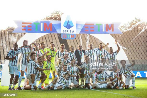 Juventus players celebrate with the Scudetto after the Serie A match between Juventus and AS Roma on August 01, 2020 in Turin, Italy.