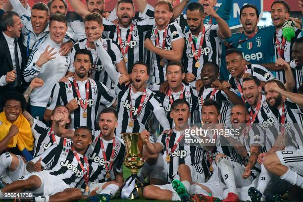 Juventus' players celebrate with the trophy after winning the Italian Tim Cup final Juventus vs AC Milan at the Olympic stadium on May 9, 2018 in...