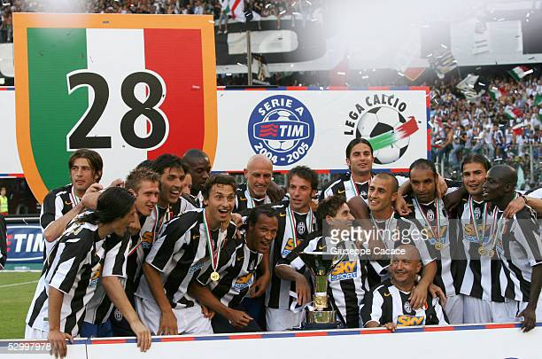 Juventus players celebrate with the trophy for the victory of scudetto at the end of the last Serie A football match of the season between Juventus...