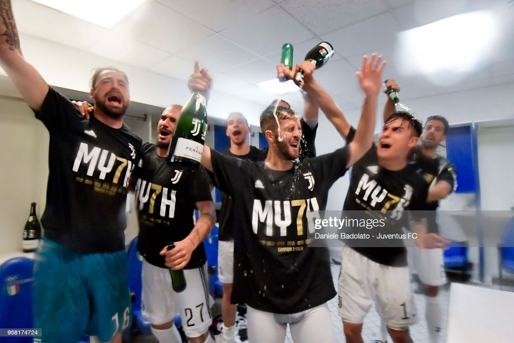 Juventus players celebrating their seventh league titles in a row after the serie A match between AS Roma and Juventus at Stadio Olimpico on May 13, 2018 in Rome, Italy.