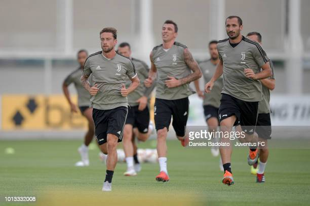 Juventus players Claudio Marchisio and Giorgio Chiellini during a Juventus training session at JTC on August 8 2018 in Turin Italy