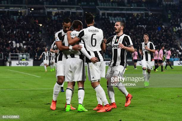 Juventus players congratulate Juventus' Italian midfielder Claudio Marchisio after he scored a goal during the Italian Serie A football match between...