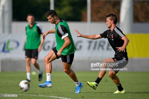 Juventus players Cristiano Ronaldo and Daniele Rugani during a training session at JTC on August 13 2019 in Turin Italy