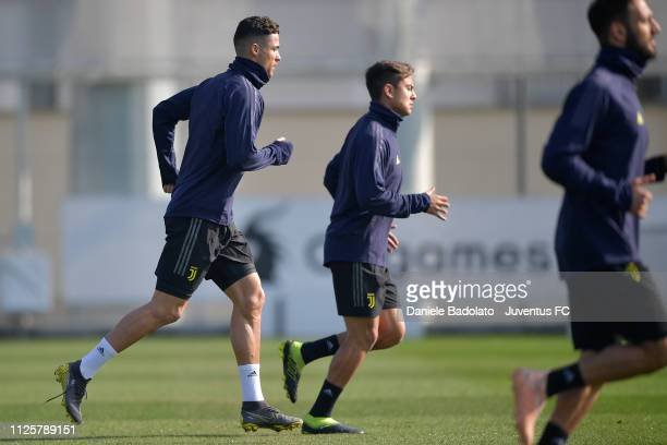 Juventus players Cristiano Ronaldo and Paulo Dybala during the Champions League training session at JTC on February 19 2019 in Turin Italy
