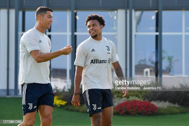 Juventus players Cristiano Ronaldo and Weston McKennie talk during a training session at JTC on September 15, 2020 in Turin, Italy.