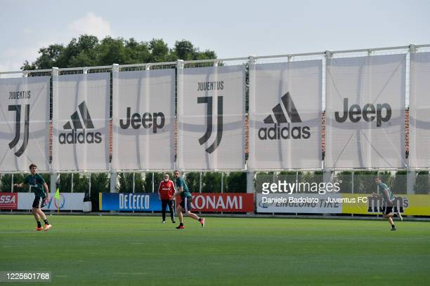 Juventus players Daniele Rugani Leonardo Bonucci and Mattia De Sciglio with coach Maurizio Sarri during a training session at JTC on May 18 2020 in...