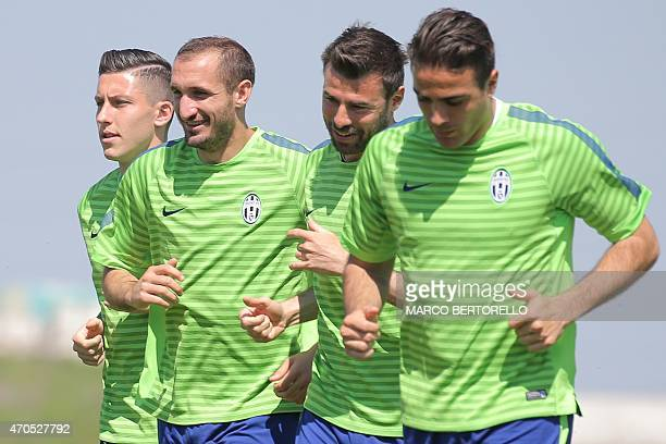 Juventus' players defender Luca Marrone defender Giorgio Chiellini and defender Andrea Barzagli take part in a training session on the eve of the...