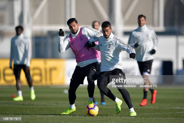Juventus players Emre Can and Leonardo Spinazzola during a training session at JTC on January 24 2019 in Turin Italy