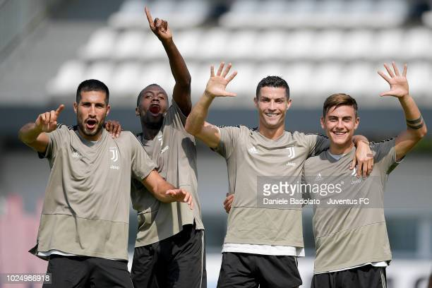 Juventus players Emre Can Blaise Matuidi Cristiano Ronaldo and Paulo Dybala during a training session at JTC on August 29 2018 in Turin Italy