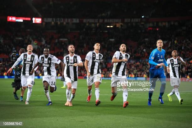 Juventus players Federico Bernardeschi Blaise Matuidi Miralem Pjanic Cristiano Ronaldo Leonardo Bonucci goalkeeper Wojciech Szczesny and Douglas...