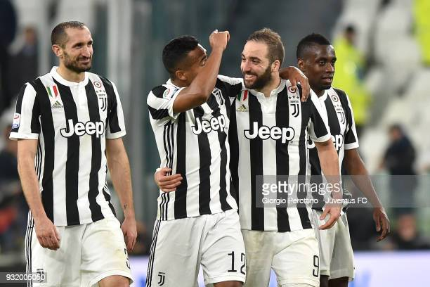 Juventus players Giorgio Chiellini Alex Sandro Gonzalo Higuain and Blaise Matuidi celebrate the victory at the end of the serie A match between...