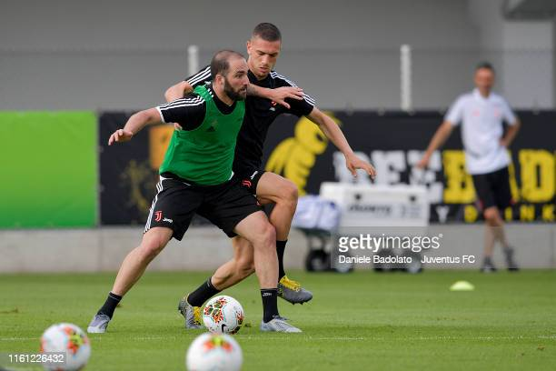 Juventus players Gonzalo Higuain and Merih Demiral fight for the ball during a training session at Jtc on July 10 2019 in Turin Italy