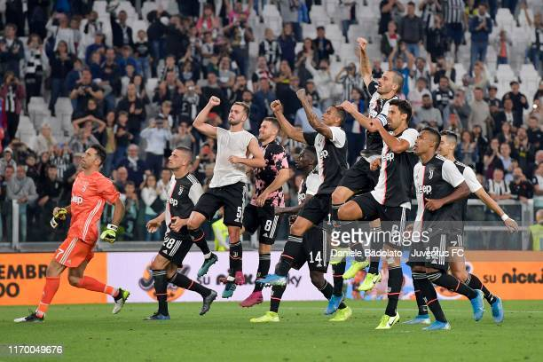 Juventus players greet the fans and celebrate the victory after the Serie A match between Juventus and Hellas Verona at Allianz Stadium on September...