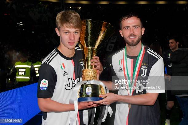 Juventus players Hans Nicolussi Caviglia and Miralem Pjanic during the Serie A match between Juventus and Atalanta BC on May 19 2019 in Turin Italy
