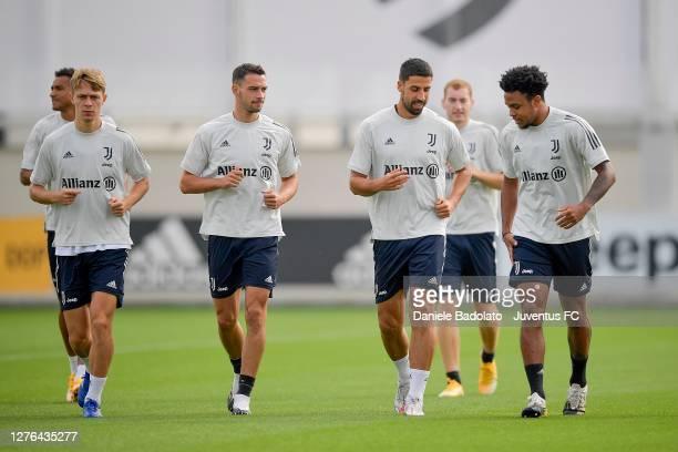 Juventus players Hans Nicolussi Caviglia, Mattia De Sciglio, Sami Khedira and Weston McKennie during a training session at JTC on September 24, 2020...