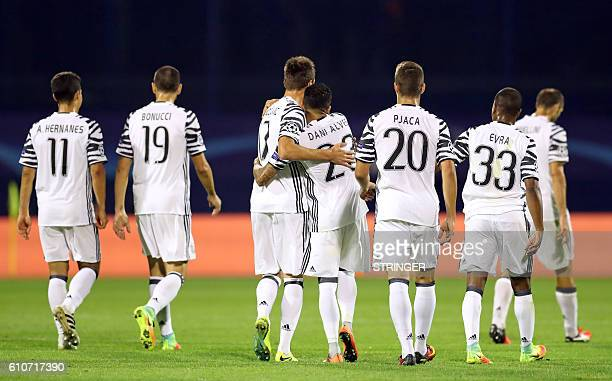 Juventus players Hernandes Leonardo Bonucci Mario Mandzukic Dani Alves Marko Pjaca and Patrice Evra celebrate their victory at the end of the UEFA...