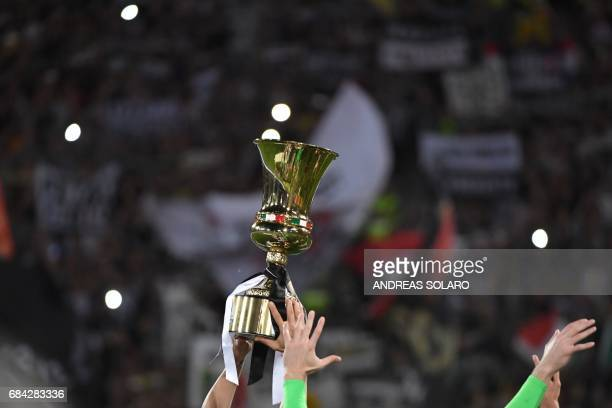 Juventus players hold the trophy after winning the Italian Tim Cup final on May 17, 2017 at the Olympic stadium in Rome. Dani Alves and Leonardo...