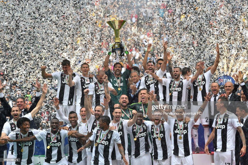 Juventus players holding the trophy after winning their seventh league titles in a row at the end of the serie A match between Juventus and Hellas Verona FC at Allianz Stadium on May 19, 2018 in Turin, Italy.