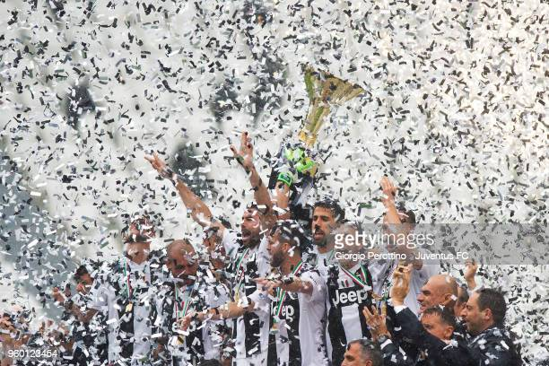 Juventus players holding the trophy after winning their seventh league titles in a row at the end of the serie A match between Juventus and Hellas...