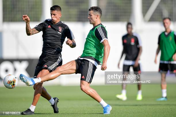 Juventus players Joao Cancelo and Cristiano Ronaldo during a training session at JTC on July 23, 2019 in Turin, Italy.