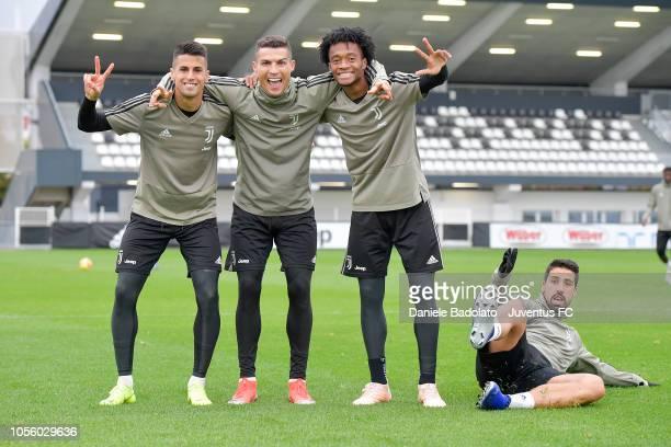 Juventus players Joao Cancelo Cristiano Ronaldo Juan Cuadrado and Sami Khedira during a training session at JTC on November 1 2018 in Turin Italy