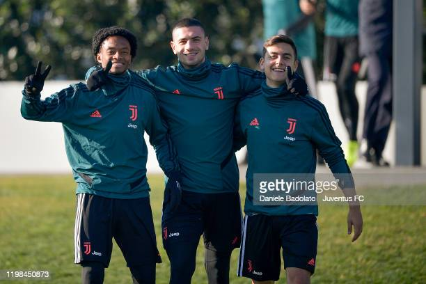 Juventus players Juan Cuadrado, Merih Demiral and Paulo Dybala pose during a training session at JTC on January 09, 2020 in Turin, Italy.