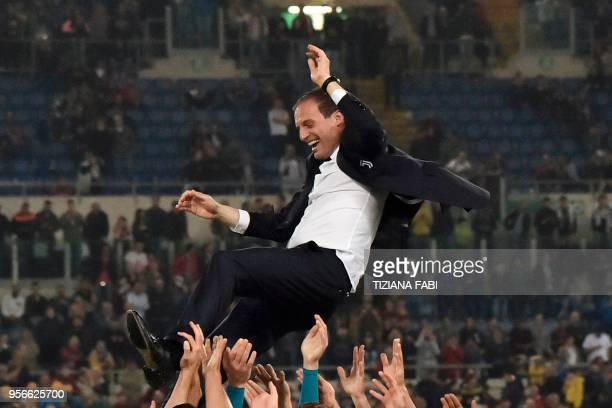 Juventus' players lift Juventus' coach from Italy Massimiliano Allegri after winning the Italian Tim Cup final Juventus vs AC Milan at the Olympic...