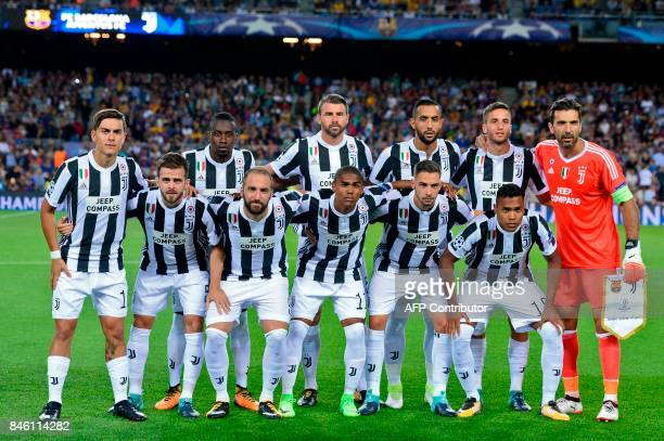 Juventus' players line up before the UEFA Champions League Group D football match FC Barcelona vs Juventus at the Camp Nou stadium in Barcelona on...
