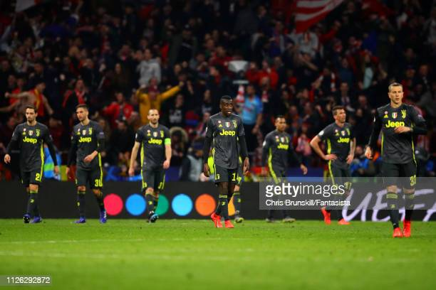 Juventus players look dejected following Club Atletico de Madrid's second goal during the UEFA Champions League Round of 16 First Leg match between...