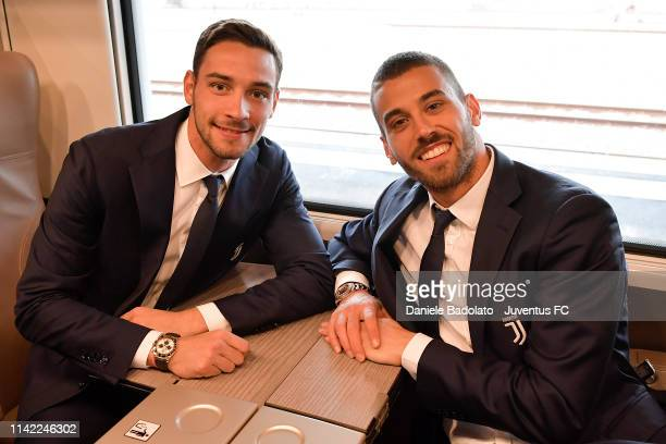 Juventus players Mattia De Sciglio and Leonardo Spinazzola travelling by train to Ferrara on April 12 2019 in Ferrara Italy