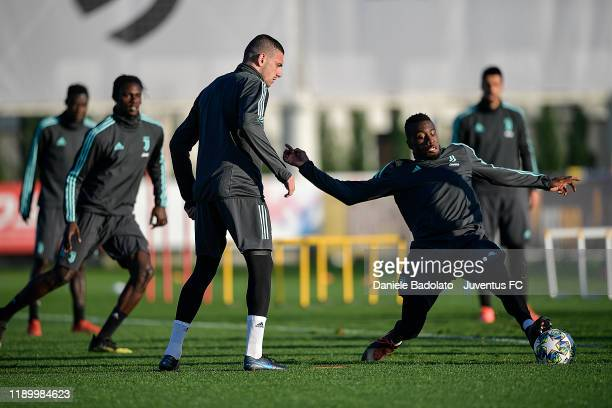 Juventus players Merih Demiral and Blaise Matuidi during the UEFA Champions League training session at JTC on November 25 2019 in Turin Italy