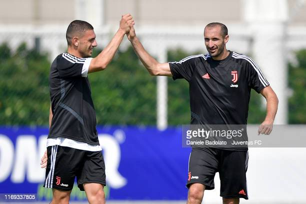 Juventus players Merih Demiral and Giorgio Chiellini during a training session at JTC on August 21 2019 in Turin Italy